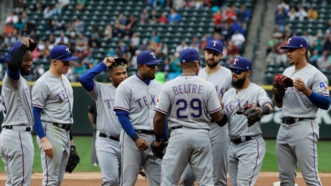 <p>               Texas Rangers' Adrian Beltre (29), is greeted by teammates before walking off the field during the fifth inning of a baseball game against the Seattle Mariners after he was replaced by Jurickson Profar at third base, Sunday, Sept. 30, 2018, in Seattle. (AP Photo/Ted S. Warren)             </p>