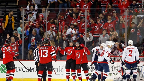 <p>               New Jersey Devils' Kyle Palmieri, center, celebrates his goal with teammates during the first period of an NHL hockey game against the Washington Capitals on Thursday, Oct. 11, 2018, in Newark, N.J. (AP Photo/Adam Hunger)             </p>