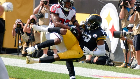 <p>               Pittsburgh Steelers wide receiver JuJu Smith-Schuster (19) makes a catch for a touchdown as Atlanta Falcons cornerback Robert Alford (23) defends in the first half of an NFL football game Sunday, Oct. 7, 2018, in Pittsburgh. (AP Photo/Don Wright)             </p>