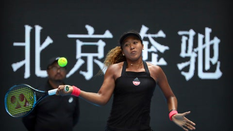 <p>               Naomi Osaka of Japan hits a return shot while competing against Zhang Shuai of China in their quarterfinal women's singles match in the China Open at the Lotus Court in Beijing, Friday, Oct. 5, 2018. (AP Photo/Mark Schiefelbein)             </p>