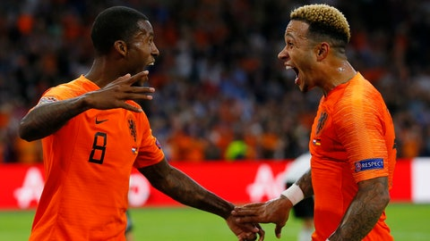 <p>               Netherland's scorer Georginio Wijnaldum, left, celebrates after he scored his side's third goal with Netherland's second scorer Memphis Depay, right, during the UEFA Nations League soccer match between The Netherlands and Germany at the Johan Cruyff ArenA in Amsterdam, Saturday, Oct. 13, 2018. The Netherlands defeated Germany with 3-0. (AP Photo/Peter Dejong)             </p>