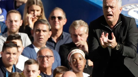 <p>               ManU coach Jose Mourinho, right, encourages his team during their English Premier League soccer match between Chelsea and Manchester United at Stamford Bridge stadium in London Saturday, Oct. 20, 2018. (AP Photo/Matt Dunham)             </p>