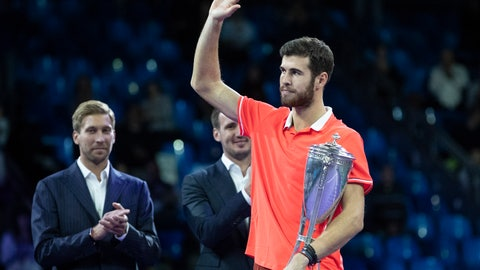 <p>               Karen Khachanov of Russia, right, holds the trophy after winning the final match of the Kremlin Cup tennis tournament against Adrian Mannarino of France in Moscow, Russia, Sunday, Oct. 21, 2018. (AP Photo/Pavel Golovkin)             </p>