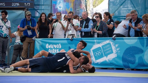 <p>               In this photo provided by the OIS/IOC, former IOC President Jacques Rogge, center, and current IOC President Thomas Bach, second from right, applaud as Argentina celebrates winning the Basketball 3x3 Men's gold medal game during The Youth Olympic Games in Buenos Aires, Argentina, Wednesday, Oct. 17, 2018. (Gabriel Heusi for OIS/IOC via AP)             </p>