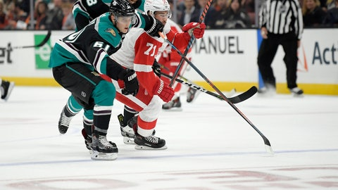 <p>               Anaheim Ducks right wing Troy Terry, left, and Detroit Red Wings center Dylan Larkin, right, battle for the puck as defenseman Marcus Pettersson (28), of Sweden, watches during the first period of an NHL hockey game Monday, Oct. 8, 2018, in Anaheim, Calif. (AP Photo/Mark J. Terrill)             </p>