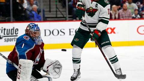 <p>               Minnesota Wild left wing Zach Parise, right, tries to redirect the puck toward Colorado Avalanche goaltender Semyon Varlamov during the second period of an NHL hockey game Thursday, Oct. 4, 2018, in Denver. (AP Photo/David Zalubowski)             </p>