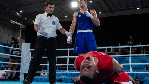 <p>               In this photo provided by the OIS/IOC, Youssef Ali Karar Ali Moussa of Egypt shows his agony after losing to Karol Itauma of Great Britain in the Boxing Men's Light Heavy semifinal, at the Oceania Pavilion during the Youth Olympic Summer Games in Buenos Aires, Argentina, Tuesday, Oct. 16, 2018 (Ian Walton /OIS/IOC via AP)             </p>