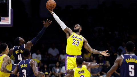 <p>               FILE - In this Sept. 30, 2018, file photo, Los Angeles Lakers forward LeBron James (23) grabs a rebound over Denver Nuggets forward Paul Millsap (4) during the first half of an NBA preseason basketball game in San Diego. The NBA's 73rd season starts Tuesday night, beginning a year where LeBron James will play for the Los Angeles Lakers. (AP Photo/Gregory Bull)             </p>