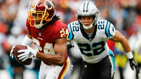 <p>               Washington Redskins cornerback Josh Norman (24) carries the ball after pulling in an interception as Carolina Panthers running back Christian McCaffrey (22) pursues him during the first half of an NFL football game, Sunday, Oct. 14, 2018, in Landover, Md. (AP Photo/Patrick Semansky)             </p>