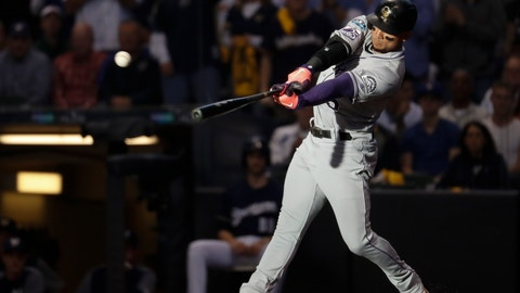 <p>               Colorado Rockies' Carlos Gonzalez hits a triple during the fifth inning of Game 1 of the National League Divisional Series baseball game against the Milwaukee Brewers Thursday, Oct. 4, 2018, in Milwaukee. (AP Photo/Jeff Roberson)             </p>