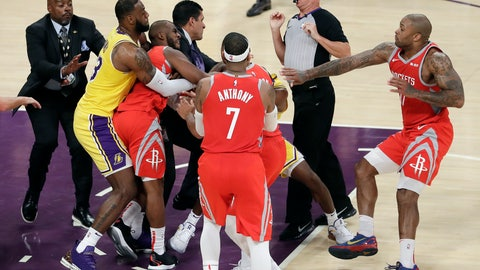 <p>               Houston Rockets' Chris Paul, second from left, is held back by Los Angeles Lakers' LeBron James, left, as Paul fights with Lakers' Rajon Rondo, center obscured, during the second half of an NBA basketball game Saturday, Oct. 20, 2018, in Los Angeles. The Rockets won, 124-115. (AP Photo/Marcio Jose Sanchez)             </p>