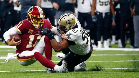 <p>               New Orleans Saints defensive tackle Sheldon Rankins (98) brings down Washington Redskins quarterback Alex Smith (11) in the first half of an NFL football game in New Orleans, Monday, Oct. 8, 2018. (AP Photo/Butch Dill)             </p>