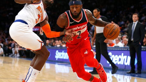 <p>               New York Knicks guard Tim Hardaway Jr. (3) defends against Washington Wizards guard John Wall (2) during the first half of a preseason NBA basketball game Monday, Oct. 8, 2018, in New York. (AP Photo/Noah K. Murray)             </p>