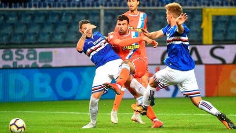 <p>               Spal's Andrea Petagna, center,  fires a shot during the Serie A soccer match between Sampdoria and Spal at the Luigi Ferraris stadium in Genoa, Italy, Monday, Oct. 1, 2018. (Luca Zennaro/ANSA via AP)             </p>