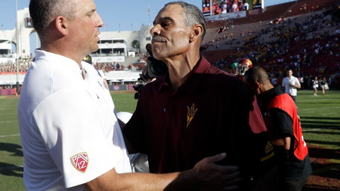 <p>               Arizona State head coach Herm Edwards, right, shakes hands with Southern California head coach Clay Helton after Arizona State's 38-35 win during an NCAA college football game Saturday, Oct. 27, 2018, in Los Angeles. (AP Photo/Marcio Jose Sanchez)             </p>