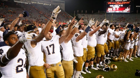 <p>               Notre Dame players celebrate a 45-23 win over Virginia Tech in an NCAA college football game in Blacksburg, Va., Saturday, Oct. 6, 2018. (AP Photo/Steve Helber)             </p>