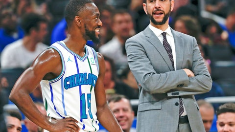 <p>               Charlotte Hornets' Kemba Walker (15) talks with head coach James Borrego while waiting for a teammate to shoot a free throw against the Orlando Magic during the second half of an NBA basketball game, Friday, Oct. 19, 2018, in Orlando, Fla. (AP Photo/John Raoux)             </p>