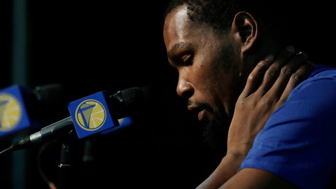 <p>               Golden State Warriors' Kevin Durant listens to a question from a reporter before the team's NBA preseason basketball game against the Sacramento Kings, Friday, Oct. 5, 2018, in Seattle. (AP Photo/Ted S. Warren)             </p>
