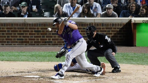 <p>               Colorado Rockies' Matt Holliday (7) hits a double against the Chicago Cubs during the fourth inning of the National League wild-card playoff baseball game, Tuesday, OCT. 2, 2018, in Chicago. (AP Photo/David Banks)             </p>