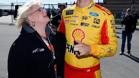 <p>               Driver Joey Logano, right, talks with a fan before practicing for the NASCAR Cup Series auto race at Kansas Speedway in Kansas City, Kan., Saturday, Oct. 20, 2018. (AP Photo/Colin E. Braley)             </p>