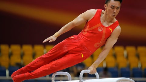 <p>               China's Sun Wei performs on the pommel horse during the men's team final of the Gymnastics World Chamionships at the Aspire Dome in Doha, Qatar, Monday, Oct. 29, 2018. (AP Photo/Vadim Ghirda)             </p>