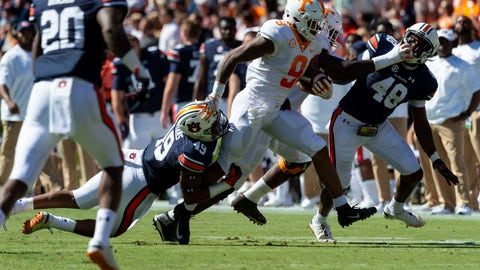<p>               Auburn linebacker Darrell Williams (49) drags down Tennessee running back Tim Jordan (9) during the first half of an NCAA college football game, Saturday, Oct. 13, 2018, in Auburn, Ala. Auburn linebacker Montavious Atkinson (48) trails on the play. (AP Photo/Vasha Hunt)             </p>