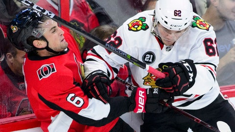 <p>               Ottawa Senators defenseman Chris Wideman gets hit by Chicago Blackhawks center Luke Johnson during the second period of an NHL hockey game Thursday, Oct. 4, 2018, in Ottawa, Ontario. (Sean Kilpatrick/The Canadian Press via AP)             </p>