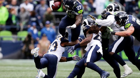 <p>               Seattle Seahawks running back Mike Davis (27) leaps over Los Angeles Rams strong safety John Johnson, lower left, during the second half of an NFL football game, Sunday, Oct. 7, 2018, in Seattle. (AP Photo/Scott Eklund)             </p>