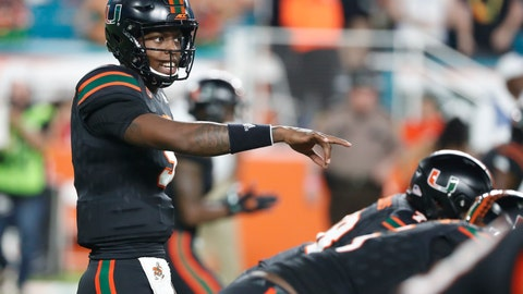 <p>               Miami quarterback N'Kosi Perry calls a play during the first half of the team's NCAA college football game against North Carolina, Thursday, Sept. 27, 2018, in Miami Gardens, Fla. Perry completed eight of 12 passes for 125 yards with one touchdown and one interception in his debut as the Miami starter. Miami defeated North Carolina 47-10. (AP Photo/Wilfredo Lee)             </p>