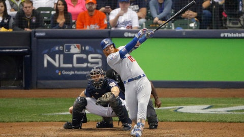 <p>               Los Angeles Dodgers' Justin Turner (10) hits a two-run home run during the eighth inning of Game 2 of the National League Championship Series baseball game against the Milwaukee Brewers Saturday, Oct. 13, 2018, in Milwaukee. (AP Photo/Charlie Riedel)             </p>