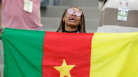 "<p>               FILE - In this Sunday, June 25, 2017 file photo, a Cameroon fan holds a flag prior to the Confederations Cup, Group B soccer match between Germany and Cameroon, at the Fisht Stadium in Sochi, Russia. The head of the African soccer confederation says the body has ""never thought"" of removing Cameroon as host of next year's African Cup of Nations, a statement at odds with its position last week when it declined to back the country until at least two more inspection visits. Confederation of African Football president Ahmad, who goes by one name, said Tuesday, Oct. 2, 2018 the tournament ""depends on Cameroon not CAF."" (AP Photo/Thanassis Stavrakis, file)             </p>"