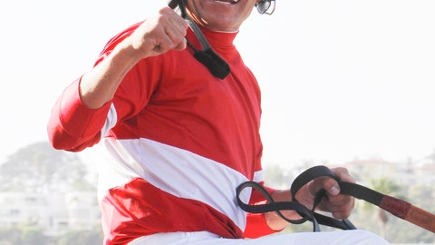 <p>               FILE - In this Aug. 28, 2011, file photo, jockey Patrick Valenzuela, sitting aboard Acclamation, celebrates victory in the $1 million Pacific Classic horse race at Del Mar Thoroughbred Club in Del Mar, Calif. Valenzuela has pleaded guilty to misdemeanor domestic violence for slapping his girlfriend at a Southern California restaurant. The San Diego Union-Tribune reported Friday, Oct. 19, 2018, that the seven-time Breeders Cup winner entered the plea earlier this week, was fined nearly $900 and ordered to take domestic violence recovery classes. (AP Photo/Lenny Ignelzi, File)             </p>