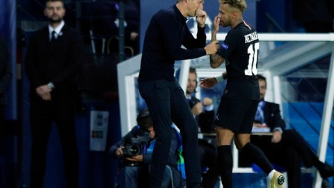 <p>               PSG forward Neymar, right, talks to PSG coach Thomas Tuchel after he was replaced by PSG forward Julian Draxler during the group C Champions League soccer match between Paris Saint Germain and Red Star Belgrade at the Parc des Princes stadium in Paris, France, Wednesday, Oct. 3, 2018. (AP Photo/Francois Mori)             </p>