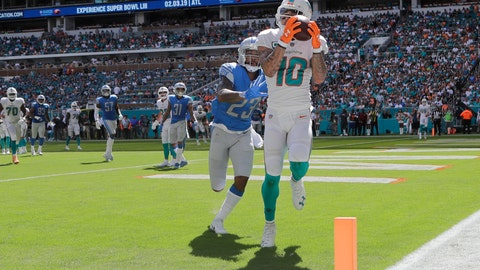 <p>               Miami Dolphins wide receiver Kenny Stills (10) catches a touchdown pass ahead of Detroit Lions cornerback Darius Slay (23), during the first half of an NFL football game, Sunday, Oct. 21, 2018, in Miami Gardens, Fla. (AP Photo/Lynne Sladky)             </p>
