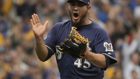 <p>               Milwaukee Brewers starting pitcher Jhoulys Chacin reacts after Colorado Rockies' Trevor Story strikes out during the first inning of Game 2 of the National League Divisional Series baseball game Friday, Oct. 5, 2018, in Milwaukee. (AP Photo/Morry Gash)             </p>
