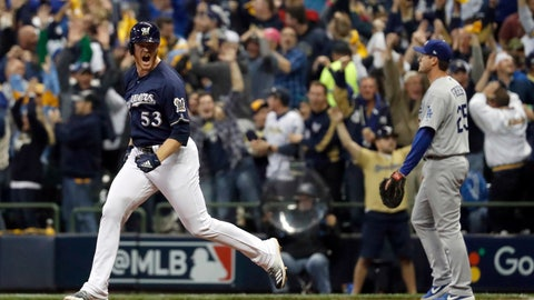 <p>               Milwaukee Brewers' Brandon Woodruff (53) celebrates after hitting a home run during the third inning of Game 1 of the National League Championship Series baseball game against the Los Angeles Dodgers Friday, Oct. 12, 2018, in Milwaukee. (AP Photo/Jeff Roberson)             </p>