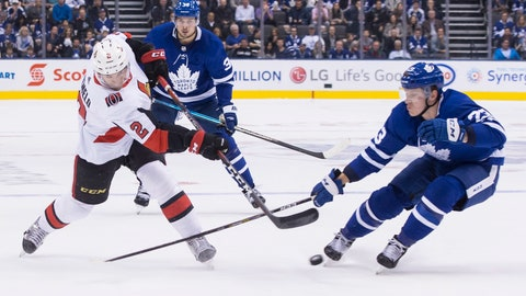 <p>               Ottawa Senators' Dylan DeMelo (2) gets a shot away as Toronto Maple Leafs' Travis Dermott (23) closes in during first period NHL hockey action in Toronto on Saturday, Oct. 6, 2018. (Chris Young/The Canadian Press via AP)             </p>