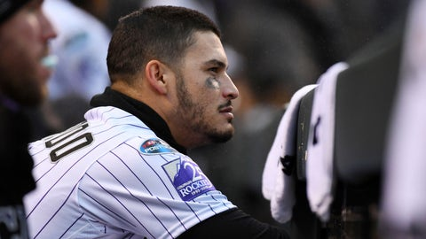 <p>               Colorado Rockies third baseman Nolan Arenado sits in the dugout in the ninth inning of Game 3 of a baseball National League Division Series against the Milwaukee Brewers Sunday, Oct. 7, 2018, in Denver. The Brewers won 6-0 to sweep the series in three games and move on to the National League Championship Series. (AP Photo/John Leyba)             </p>