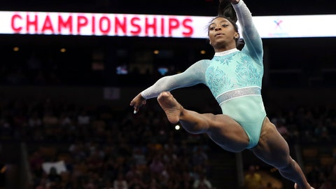 <p>               FILE - In this Aug. 19, 2018, file photo, Simone Biles competes on the floor exercise at the U.S. Gymnastics Championships in Boston. The four-time Olympic gold medalist and three-time world all-around champion headlines the six-woman group Team USA will send to the world championship later this month in Doha, Qatar. (AP Photo/Elise Amendola, File)             </p>