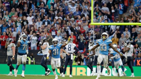 <p>               Los Angeles Chargers defensive back Adrian Phillips (31) and free safety Derwin James (33) celebrate after a successful defensive play near the end of the second half of an NFL football game against Tennessee Titans at Wembley stadium in London, Sunday, Oct. 21, 2018. Los Angeles Chargers won the match 20-19. (AP Photo/Matt Dunham)             </p>