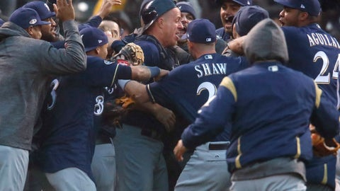 <p>               Milwaukee Brewers catcher Erik Kratz, center, is swarms by teammates after the Colorado Rockies committed the final out in the ninth inning of Game 3 of a baseball National League Division Series Sunday, Oct. 7, 2018, in Denver. The Brewers won 6-0 to sweep the series in three games and move on to the National League Championship Series. (AP Photo/David Zalubowski)             </p>