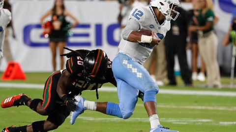 <p>               FILE - In this Sept. 27, 2018, file photo, Miami defensive back Robert Knowles (20) takes down North Carolina quarterback Chazz Surratt, (12) running for yardage, during the first half of an NCAA college football game in Miami Gardens, Fla. (AP Photo/Wilfredo Lee, File)             </p>