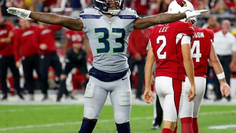 <p>               Seattle Seahawks defensive back Tedric Thompson (33) celebrates a missed field goals by Arizona Cardinals kicker Phil Dawson (4) during the second half of an NFL football game, Sunday, Sept. 30, 2018, in Glendale, Ariz. The Seahawks won 20-17. (AP Photo/Rick Scuteri)             </p>