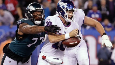 <p>               Philadelphia Eagles defensive end Michael Bennett (77) strips the ball from New York Giants quarterback Eli Manning during the first half of an NFL football game Thursday, Oct. 11, 2018, in East Rutherford, N.J. (AP Photo/Julio Cortez)             </p>