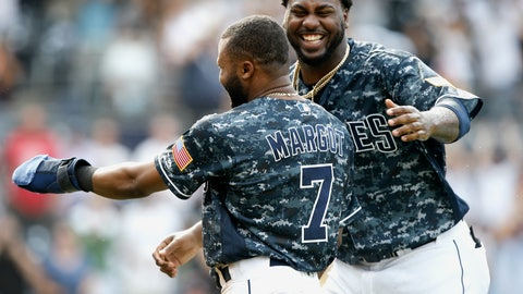 <p>               San Diego Padres' Franmil Reyes, right, congratulates Manuel Margot, left, after Margot slides safely into home from third base, after Arizona Diamondbacks catcher John Ryan Murphy threw to first to get Francisco Mejia, after striking out swinging during the 10th inning of a baseball game in San Diego, Sunday, Sept. 30, 2018. The Padres won 4-3, in 10 innings. (AP Photo/Alex Gallardo)             </p>