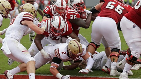 <p>               North Carolina State's Reggie Gallaspy II (25) scores a touchdown as State's Joshua Fedd-Jackson (66) blocks Boston College's Zach Allen (2) during the first half an NCAA college football game in Raleigh, N.C., Saturday, Oct. 6, 2018. (AP Photo/Gerry Broome)             </p>