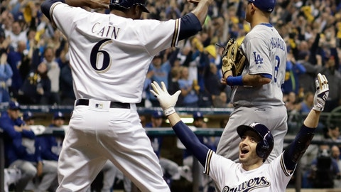 <p>               Milwaukee Brewers' Ryan Braun celebgrates with Lorenzo Cain after scoring on a double by Jesus Aguilar during the first inning of Game 6 of the National League Championship Series baseball game against the Los Angeles Dodgers Friday, Oct. 19, 2018, in Milwaukee. (AP Photo/Matt Slocum)             </p>