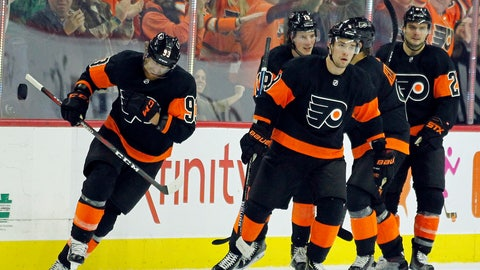 <p>               Philadelphia Flyers' Jakub Voracek, left, skates ahead of his teammates after celebrating his goal that broke the tie in the third period of an NHL hockey game, against New Jersey Devils, Saturday, Oct. 20, 2018, in Philadelphia. The Flyers won 5-2. (AP Photo/Tom Mihalek)             </p>