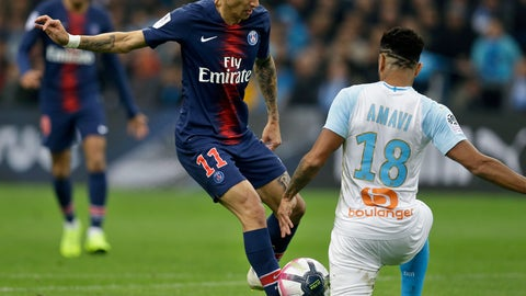 <p>               PSG's Angel Di Maria, left, challenges for the ball with Marseille's Jordan Amavi, during the French League One soccer match between Paris-Saint-Germain and Marseille at the Velodrome Stadium in Marseille, France, Sunday, Oct. 28, 2018. (AP Photo/Claude Paris)             </p>