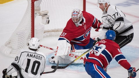 <p>               Montreal Canadiens goaltender Carey Price (31) is pressured by Los Angeles Kings' Michael Amadio (10) and Jeff Carter (77) as Canadiens' Matthew Peca looks for a rebound during the second period of an NHL hockey game Thursday, Oct. 11, 2018, in Montreal. (Graham Hughes/The Canadian Press via AP)             </p>